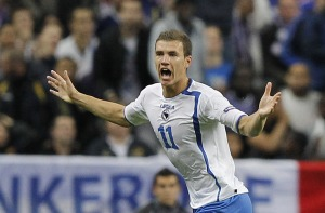 Bosnia's forward Edin Dzeko celebrates a